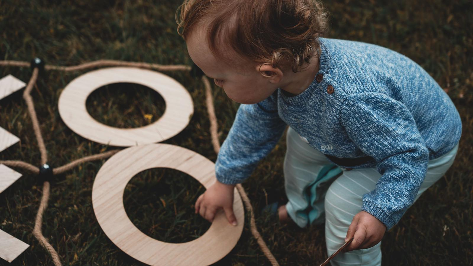 child playing noughts and crosses