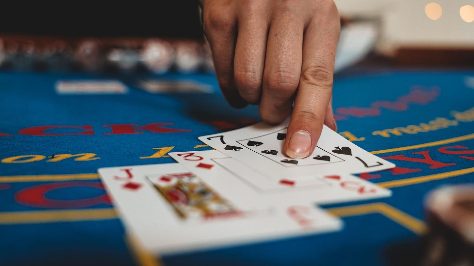 croupier dealing blackjack card