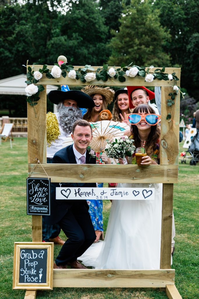 photo frame with prop box and guests